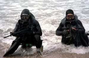 Navy Seals coming out of water.